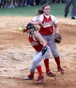 Tabitha Allen throws out a runner at first base as Victoria Williams looks on. (Photo by Mike Gowan)