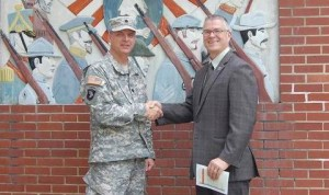Lt. Col Andrew Batten of the South Carolina National Guard and Williamston Mayor Mack Durham shake hands following a ceremony in which the SCNG turned ownership of the local Armory to the Town of Williamston.